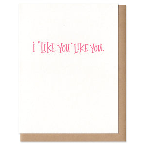 "Greeting card and kraft paper envelope. Hand written text that reads, ""I 'like you' like you"""