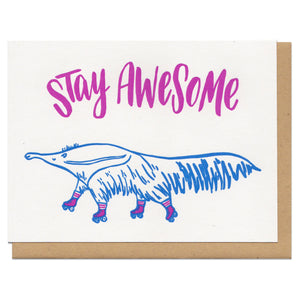 "white greeting card with an illustrated ant-eater on rollerskates beneath hand-lettering that reads ""stay awesome"""