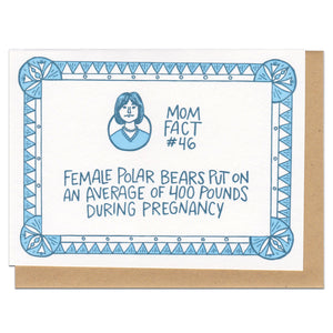 "white greeting card with blue illustrated border and a portrait of a short-haired woman. blue hand-lettering in the middle of the card reads ""mom fact #46, female polar bears put on an average of 400 pounds during pregnancy"""