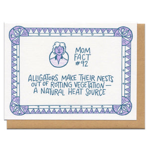 "white greeting card with purple and blue illustrated border and a portrait of a short-haired woman. blue hand-lettering in the middle of the card reads ""mom fact #92 alligators make their nests out of rotting vegatation - a natural heat source"""