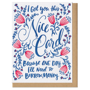 "Greeting card with kraft paper envelope. Hand-written text in fancy, script font that reads, ""I got you this nice card because one day I'll need to borrow money."" Surrounded by navy and pink flowers and leaves."