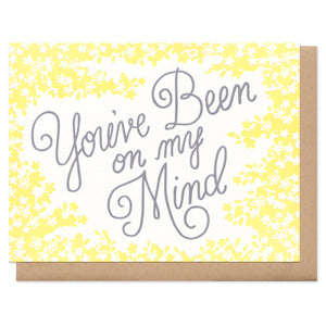 "greeting card with yellow flowers which reads ""you've been on my mind"""