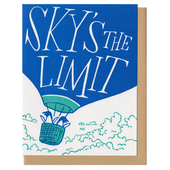 white greeting card featuring an illustration of two penguins riding in a hot air balloon. hand-lettering on the balloon reads