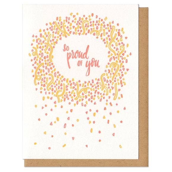 white greeting card with an illustrated circle of yellow and orange confetti surrounded hand-lettering that reads