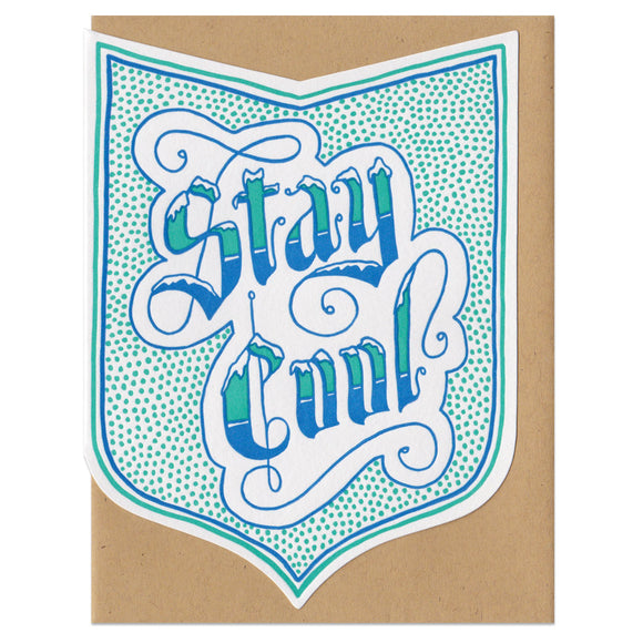 badge-shaped greeting card printed in blue and teal with a dot pattern surrounding handlettering that reads