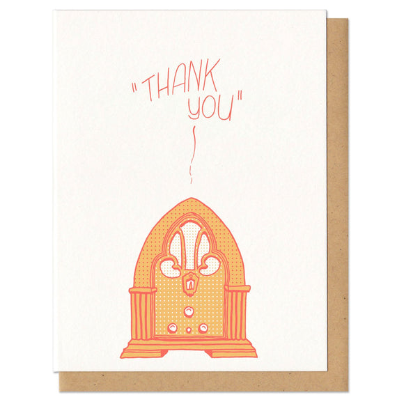 white greeting card with an illustrated old fashioned radio, printed in orange, beath hand-lettering that reads