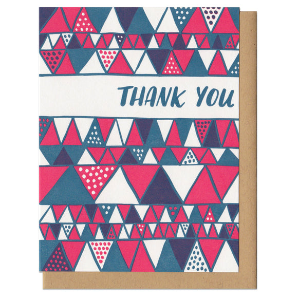 white greeting card with a red and blue illustrated triangles pattern and hand lettering that reads