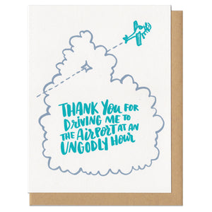 "white greeting card with an illstration of an aeroplane flying through a cloud, teal hand-lettering on the cloud reads ""thank you for driving me to the airport at an ungodly hour"""