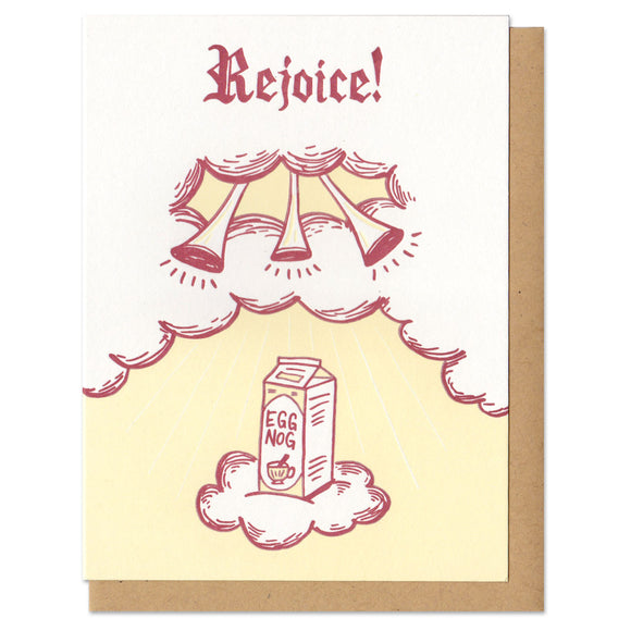 white greeting card featuring a maroon and yellow illustration of a carton of eggnog ascending twards trumpets in the clouds. hand lettering at the top reads