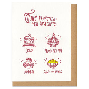 "white greeting card with maroon writing that reads ""they presented unto him gifts: gold, frank-incense, myrth, side of guac"" featuring a small illustration above each gift"