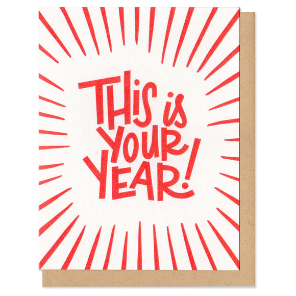 white greeting card with red lines and hand-lettering that reads