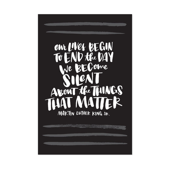 black postcard featuring a hand-lettered quote