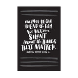 "black postcard featuring a hand-lettered quote ""Our lives begin to end the day we become silent about things that matter. Martin Luther King JR."""