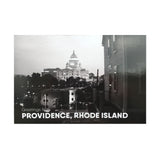 "postcard of a black and white photograph of the RI state house at night behind some buildings and trees. white text reads ""Providence, Rhode Island"""