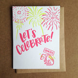"Greeting card and kraft paper envelope. Text reads, ""Let's celebrate!"" Illustration of fireworks with dog below, shaking, holding a sign that says, ""quietly."""