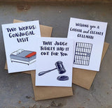"""two words: conjugal visit"", ""wishing you a cordial and cleanly cellmate"", and ""that judge totall had it out for you"" greeting cards photographed together"