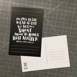 "black postcard featuring a hand-lettered quote ""Our lives begin to end the day we become silent about things that matter. Martin Luther King JR."", also showing the backside with room for an address, note, and stamp"