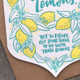 "deatil close up of illustrated lemons and handlettering that reads ""try to figure out something to do with those lemons"""