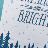 close up detail of the star pattern, some trees, and some hand-lettering