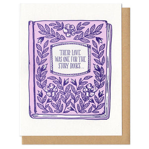 "white greeting card with a pink and purple illustrated floral book-cover, it's titled ""their love was one for the storybooks..."""