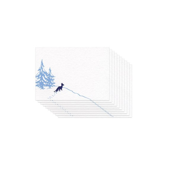 small flat white card with an illustration of wolf and two pine trees, pictured in a stack of 10