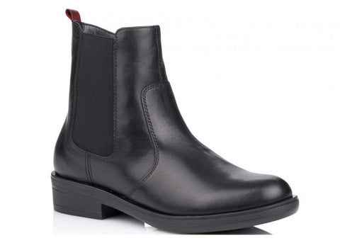 Black Chelsea boot style ankle boot with red stripe at the back. Fleece lined. Zip closure.