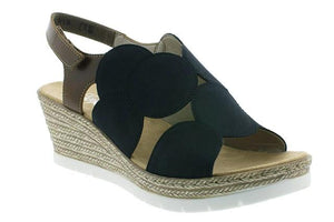 Wedge heeled sandal from Rieker with an abstract navy design.