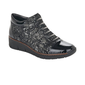 black ankle boots with floral pattern and patent toe and heel