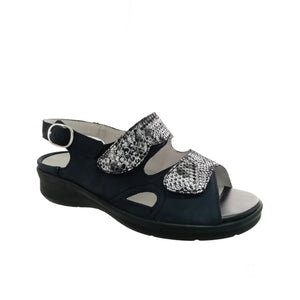 Women's navy sandal from Waldlaufer with silver metallic reptile print panels. Features double velcro closure across the foot and snap closure at the ankle
