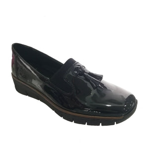 black patent slip on loafers from Rieker with a small wedge heel and a tassel detail