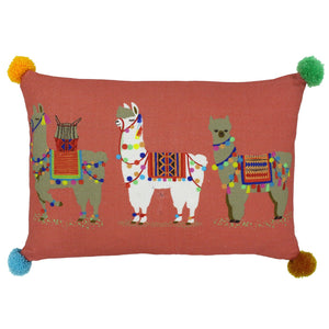 salmon pink cushion featuring 3 llamas and pom poms on each corner