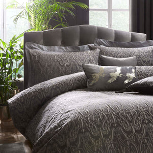 Duvet set on a bed with cushions in slate colour