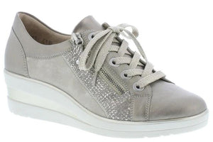 women's beige and metallic silver wedge trainer shoes from Remonte feature both zip and lace closure