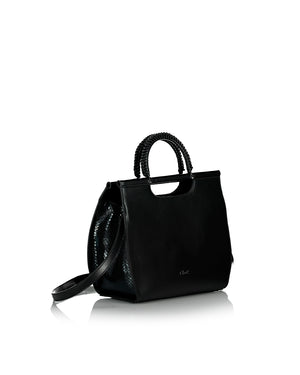 Black hand bag with a sholder strap side view