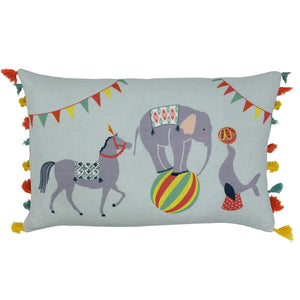 light blue-green cushion featuring colourful circus animals and tassel detail trim