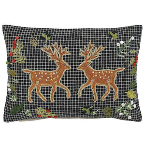 black & white houndstooth cushion with embroidered deer and festive greenery