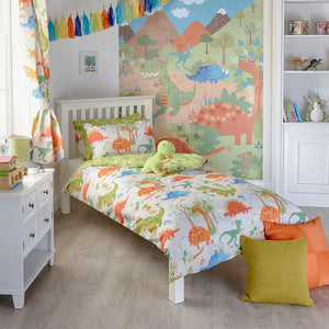 Dinosaur duvet set in a bed room with cushions and matching curtains