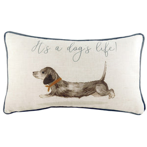 "off-white rectangular cushion with a sausage dog print and ""It's a dog's life!"" quote"