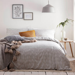 grey duvet set with a white geometric pattern