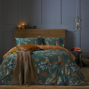 deep green duvet set featuring forest animals and plants