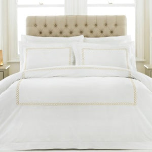White duvet set with delicate gold embroidered trim.