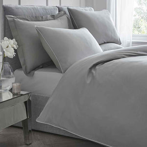 grey bed sheets and pillowcases