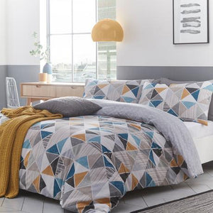 duvet set with a geometric pattern of yellows, greys, and blues