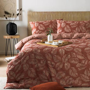 red duvet set with leaves and woven patterns