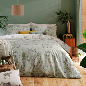 Jungle animals and greenery on a fresh green base. The bed is set against a green bedroom wall.