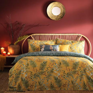 duvet set featuring a jungle print on a golden yellow base with a green leaf print reverse