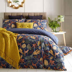 navy duvet set with monkey patterns on a bed room setting
