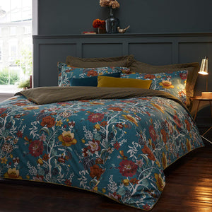 teal blue duvet set with floral pattern in white, red, and golden yellows