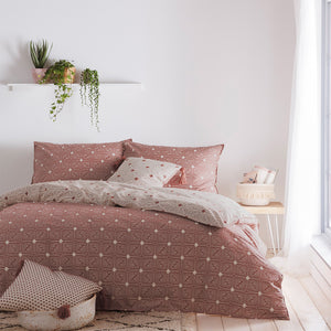 red duvet set with beige geometric pattern of spots and lines