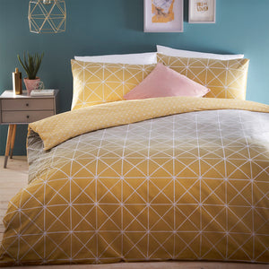 Yellow duvet cover on a bed with pillow cases